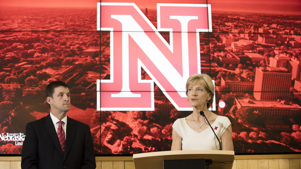 UNL's Sue Sheridan, who chaired the chancellor search committee, and Hank Bounds, University of Nebraska president, discuss the search process before Ronnie Green was introduced as UNL's new leader.