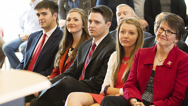 Ronnie Green's family watches during his acceptance remarks on April 6 in the Van Brunt Visitors Center. Pictured (from right) is Green's wife, Jane, and children, Reagan, Nate, Kelli and Justin.