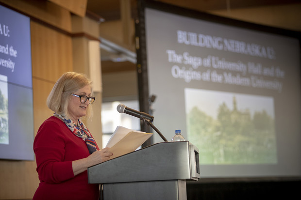 Kay Logan-Peters opens her Nebraska Lecture on Feb. 12. The talk examined stories about the buildings as well as the people who helped design, build and use them.