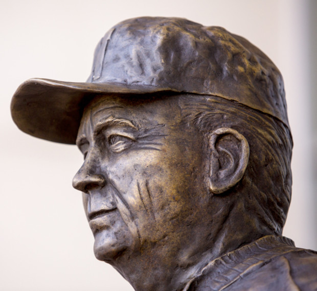 A commissioned statue of Hall-of-Fame football coach and former Cornhusker athletic director Bob Devaney was installed in the new East Memorial Stadium plaza Friday afternoon.