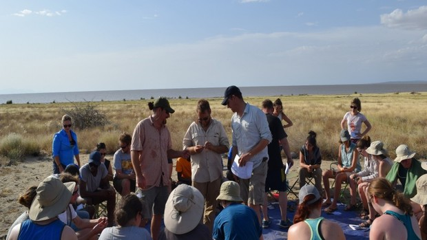 Matthew Douglass (center) and colleagues instruct students from U.S. and African universities in stone artifact identification at the Koobi Fora Base Camp.