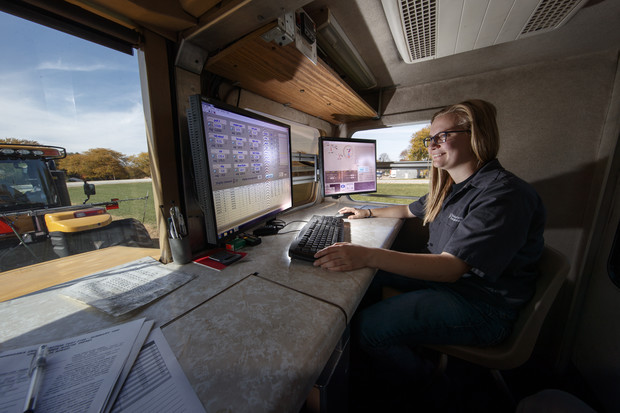 Jordan Bothern, a junior mechanized systems management major, monitors computer readouts in a test car being pulled at the Nebraska Tractor Test Laboratory.