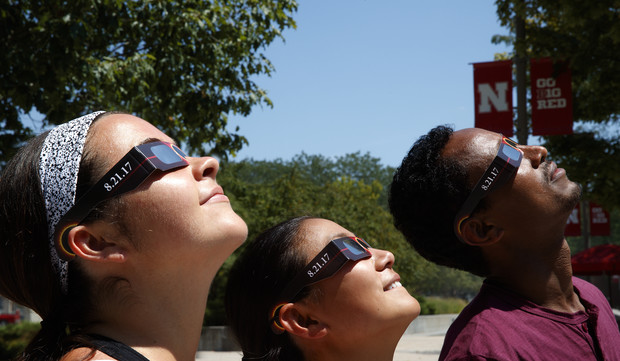 Students look at the sun using specialized glasses. The university will provide the glasses to students for the Aug. 21 total solar eclipse.