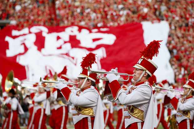 The Cornhusker Marching Band performs at the start of the Sept. 2 game with Arkansas State University. More than 30 members of the band are participating in the 22in22 Challenge, which is designed to raise awareness about veteran suicides and raise funds for veteran support services.