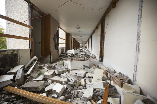 Walls between rooms on the fourth floor of Cather Hall have been turned to rubble as part of implosion prep.