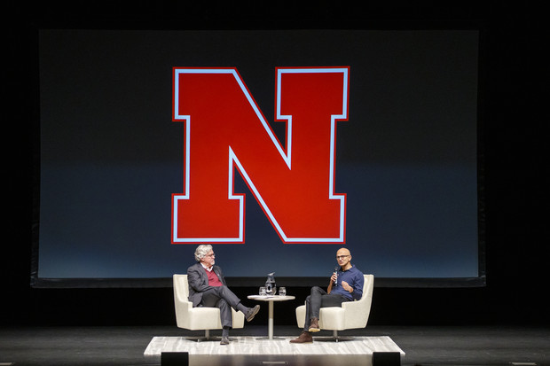 Microsoft CEO Satya Nadella (right) talks with Jeffrey S. Raikes at the Lied Center for Performing Arts on April 18. Nearly 1,000 attended the N150 event.