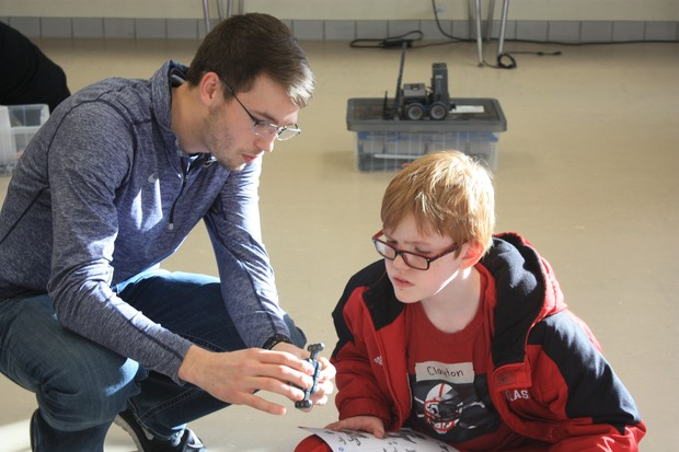 Nebraska student Colton Harper mentors a student at Culler Middle School as part of a robotics club formed in January.