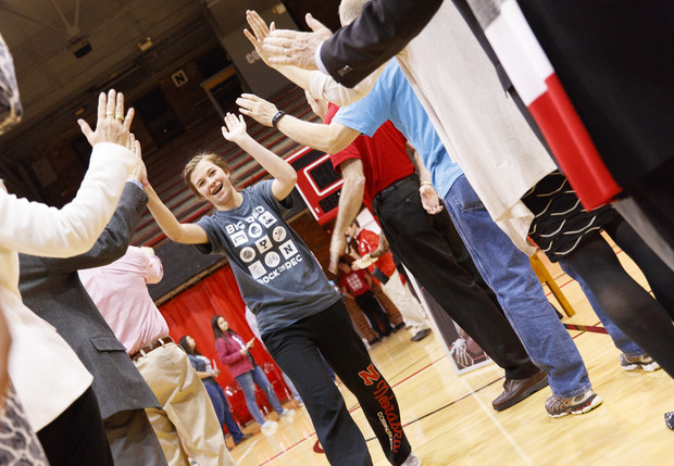 An FFA member and University of Nebraska-Lincoln commit receives high-fives during the signing ceremony April 6 at the Coliseum.