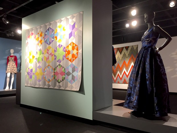 (Foreground) Park Bench Quilt, Eliana Babcock of Waverly, 15; hand-beaded blue gown, Marta Pulfer of Wayne, 18; (background) plaid jumper with red sweater, Karla Herrarte of Lexington, 12; Zig Zag Fall Colors, Sarah Lucht of Kearney, 15.