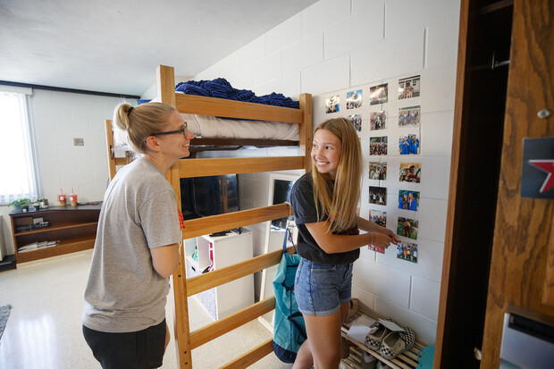 Miqaela Davis (right), from Omaha, smiles at her mom, Monica, after finishing decorating one of her walls in August 2020. The majority of Husker students using the residence halls will move in Aug. 15-19, with curbside service again provided.