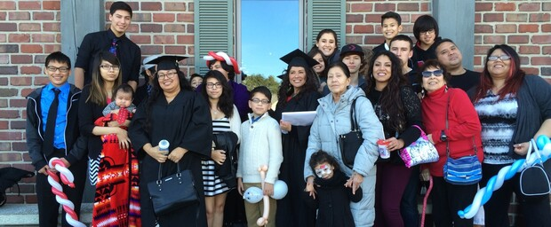 Two graduates of the Indigenous ROOTS Teacher Education Program gather with their families. A new grant will allow the program to expand its efforts and focus on training Indigenous school principals and administrators.