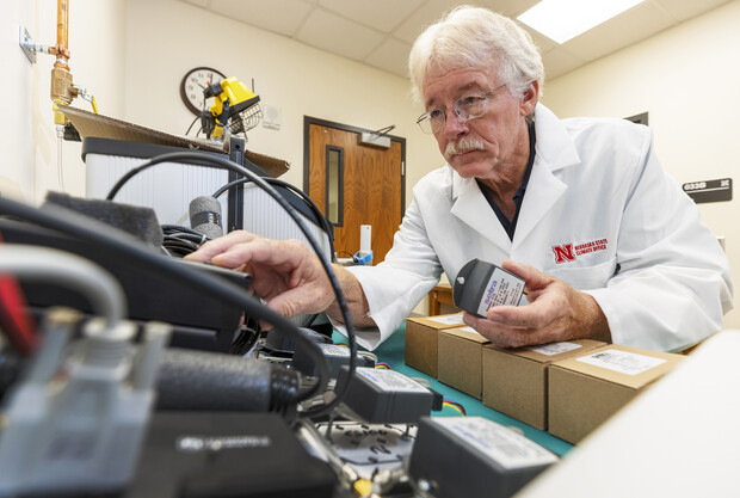 Senior Nebraska Mesonet technician Glen Roebke runs tests on a set of weather station barometers. A new sensor calibration lab has been developed by the Nebraska State Climate Office in Nebraska's School of Natural Resources.