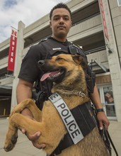 K-9 handler Russ Johnson and Layla pose outside the Stadium Drive Parking Garage prior to the April 15 spring game.