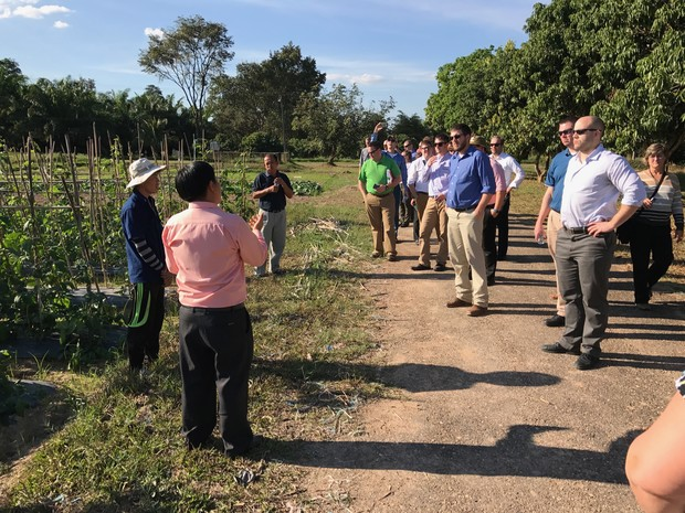 LEAD 35 fellows listen to researchers discuss vegetable cropping systems at the Development and Agricultural Services Center located outside of Vientiane, Laos.