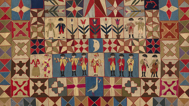 """Detail of """"Intarsia Quilt with Soldiers and Musicians,"""" which is featured in the """"War and Pieced"""" exhibition at the quilt museum. This quilt was made by a Prussian soldier between 1760 and 1780."""