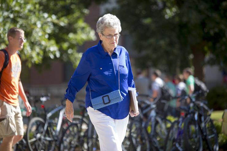 Jean Kops makes her way across the UNL campus following a recent class.