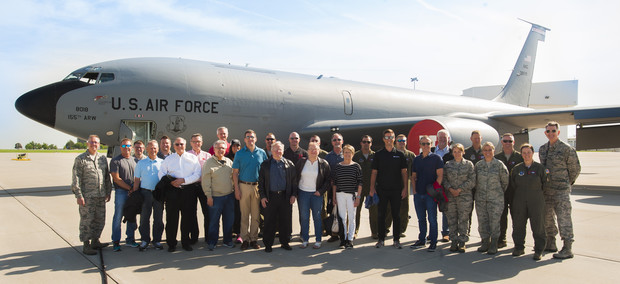 Participants in the May 24 civic leader flight line up in front of a Nebraska National Guard KC-135R Stratotanker prior to the flight. The flights are offered regularly to allow civilians to experience what a midair refueling operation.
