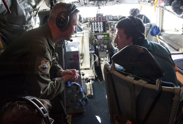Hank Bounds, president of the NU system, talks with a member of Nebraska National Guard's 155th Air Refueling Wing during the May 24 flight.