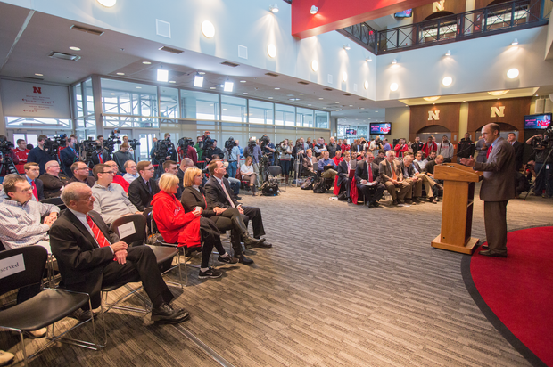Administrators, staff, student-athletes and members of the media listen to Husker head coach Mike Riley's introductory news conference.