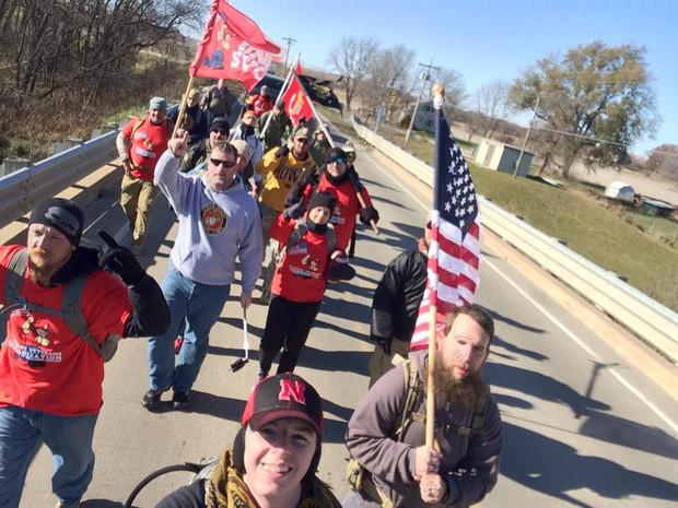 Team Nebraska marches along a highway on its way to Iowa City. More than 200 volunteers are helping with the march.