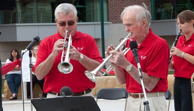 John (from left) and his father, Bill Scott, are both members of the Polonairs, a polka band based out of Omaha. Bill Scott is a long-time supporter of the university and is celebrating his 91st birthday today.