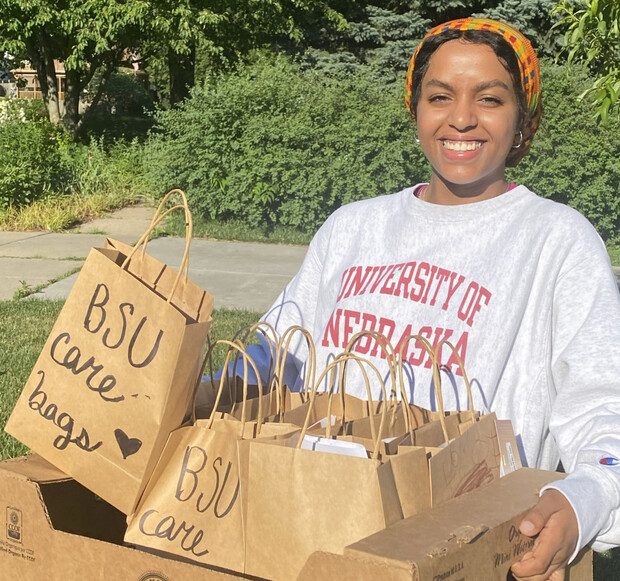 Batool Ibrahim smiles as she carries Black Student Union Care Bags that were distributed to community members in need. The project continues to seek donations.