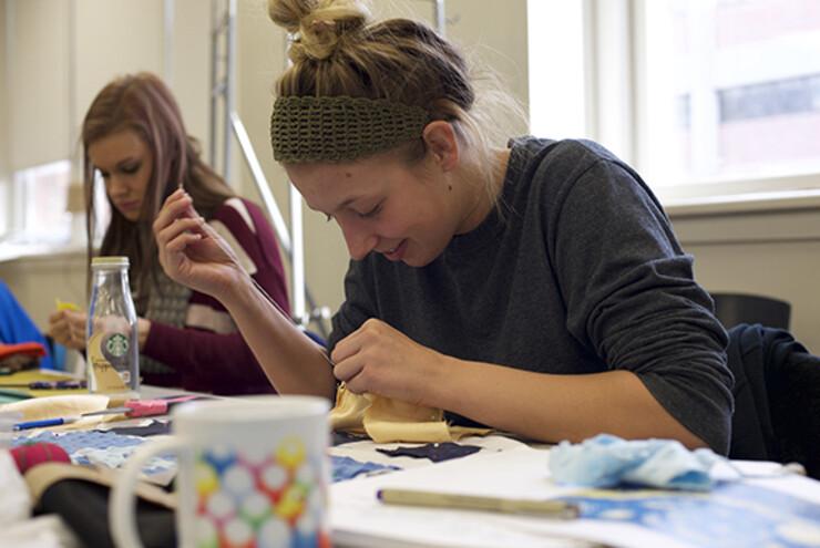"Allison Wetig, a sophomore studio art major, works on recreating Vincent Van Gogh's ""Starry Night."""